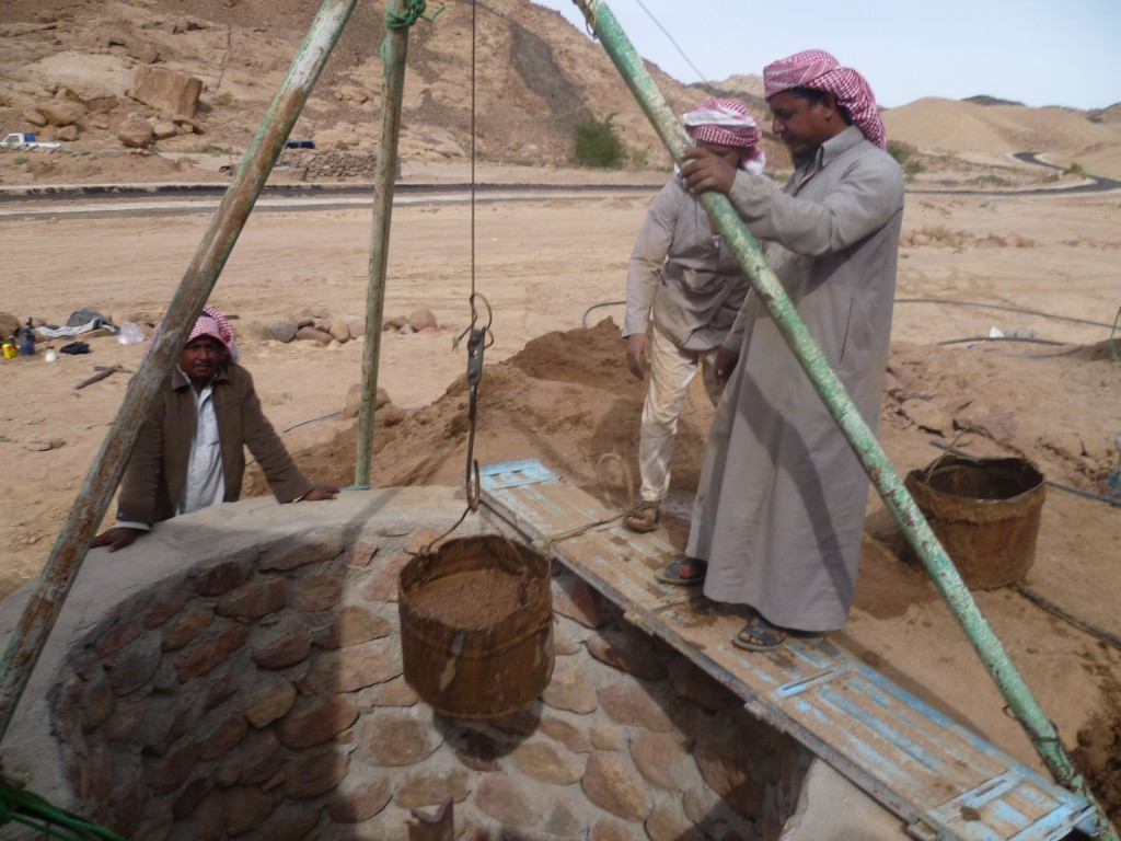 Well builders at work deepening a well in Wadi Gharba